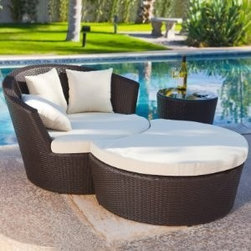 Outback Co. Palm Bay Wicker with Ottoman and End Table Patio Lounge - Oversized lounge seating with rounded backrest includes crescent-shaped ottoman and glass-top end table.