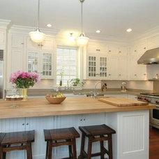 kitchens - Schoolhouse Pendant walnut stools butcher block island countertop whi