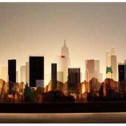 Stone Ridge Glass - Central Park South Glasscape - Kiln-polished glass forms make up this glass cityscape of New York as  seen from Central Park.  The landscape is illuminated day or night by a  light, recessed into the rear of the hardwood base, which is reflected off  the wall behind