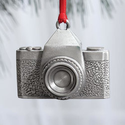"Exposures - Pewter Camera Ornament - Overview Designed exclusively for Exposures and crafted from pewter, this camera ornament will delight photography buffs. Includes ribbon for hanging.   Features Pewter Camera shape  Includes hanging ribbon Made in the USA   Specifications  Measures 2"" wide x 2"" high"