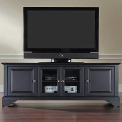 Crosley - Crosley LaFayette 60 in. Low Profile TV Stand - Black - KF10005BBK - Shop for Visual Centers and Stands from Hayneedle.com! The Crosley LaFayette 60 in. Low Profile TV Stand - Black features classic style with plenty of modern storage options. This low profile entertainment cabinet holds most 60-inch flat panel TVs and is perfectly proportioned to accommodate contemporary homes. It is crafted of hardwood and veneers with a hand rubbed multi-step black finish. Brushed nickel hardware adds a modern touch. Two raised panel doors conceal a library worth of CD/DVDs as well as media components. Two tempered glass doors add sparkle protect electronic components from dust and allow remote control access. Three adjustable shelves offer plenty of versatile storage and a cord management feature organizes wires. Perfect for a living room or bedroom!Additional Features:Accommodates up to a 60-inch flat panel TV3 adjustable shelves give 6 levels of protected storageDual tempered glass doors allow remote control access2 side cupboards with raised panel doors and 1 adjustable shelf eachCord management featureAbout Crosley FurnitureIn 1920 Powel Crosley founded the company that pioneered radio broadcasting and mass market manufacturing around the world starting with a simple radio meticulously crafted with obsessive detail and accuracy and a measure of consideration for the wallet. These high ideals have served the company well for over 90 years and they live on in the newest addition to the family. Crosley Furniture sets a new standard for innovation function and meticulous craftsmanship in the manufacture of value-priced furniture. They proudly offer durable furniture products featuring hardwood and veneer construction with rich multi-step finishes in a multitude of styles.