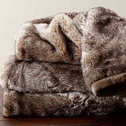 """Faux Fur Ombre Throw, Caramel - Irresistibly plush, soft and luxurious, our throw has a deep, silky pile. It's shadow printed in rich hues to create the tonal variation of a pelt. 50 x 60"""" Woven of acrylic/polyester. Ultraplush 670-gram weight. Reverses to solid polyester. Machine wash ok. But dry-clean for best results. Imported."""