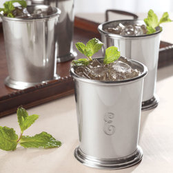 "Exposures - Polished Pewter Mint Julep Cup Personalized - Overview Crafted from fine pewter with vintage charm, this classic American-made mint julep cup is the perfect gift for yourself or anyone who appreciates fine quality and timeless appeal. A single engraved initial makes your gift even more personal.   Pewter is a sought-after precious metal alloy with an extensive history, believed to have originated nearly 3,500 years ago in Egypt. Throughout history, it was popular for use in tableware and decorative objects. Pewter is enjoying an enormous revival, as more and more people rediscover its beauty and practicality.   Features Polished pewter  Made in America   Personalization  Single engraved initial No returns on personalized items unless the item is damaged or defective   Specifications  Pewter cup measures 3"" wide x 3 3/4"" high   Shipping  Please allow 2 to 3 days for personalized items"