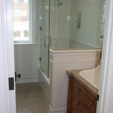 Beach Style Showers by Core Development Group, Inc.