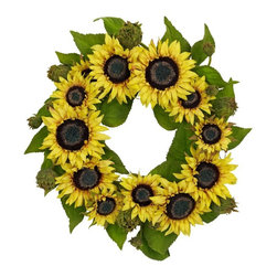 """22"""" Sunflower Wreath - Wherever you hang this bright, cheery 22 """" sunflower wreath, it'll feel like a sunny day (no matter what the weather outside is) With beautiful, bursting sunflowers circling endlessly on a sea of greenery, the warmth and good feelings just radiate forth. Yes, it's going to be summer year-round """". Buy one for your home, and one as a """"sunny """" gift for a friend or loved one. Height= 22 in x Width= 22 in x Depth= 22 in"""