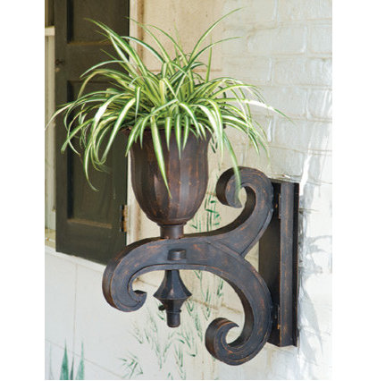 traditional outdoor planters by https://www.charlestongardens.com