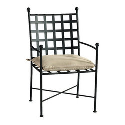 Ballard Designs - Castellon Dining Chair - Coordinates with our Castellon Outdoor Seating. Sand colored knife edge cushion included. Charcoal finish. Fully assembled. Replacement cushions available. Castellon Dining Chair requires 1 replacement cushion per chair. The simple, sculptural lines and timeless details of our Castellon Outdoor Dining Chair whisper relaxation with effortless style. Wrought iron frame is fully welded for enduring strength and powder-coated to resist moisture, chipping and rust.Castellon Dining Chair features: . . . . . Use of an outdoor furniture cover is recommended to extend the life of your piece. Made in USA.