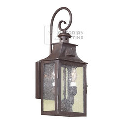 Troy Lighting - Troy Lighting Newton 60W Candelabra Traditional Outdoor Wall Sconce X-ZBO1009DCB - Vintage appeal and premium durability are the hallmarks of the Newton 60W Candelabra Traditional Outdoor Wall Sconce. The hand forged iron with an old bronze finish will not pit, corrode, or tarnish making it a smart choice for your garden, porch, or patio. The clear seeded glass provides a romantic reminder of the slower pace of older generations as it enchants with its warm glow.