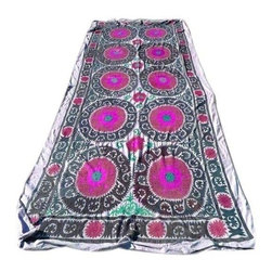 Pre-owned Embroidered Suzani Blanket - You'll fall in love with this vintage embroidered Suzani blanket, we definitely did! Colors include teal, magenta, and burnt red on a very light lavender background. This Suzani would be perfect thrown over the foot of the bed or hung up on a wall. Note: Some areas have frayed edges and embroidery.