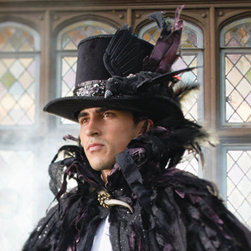 Grandin Road - Gothic Halloween Top Hat - A true work of wearable art, this generously-sized chapeau is magnificently handcrafted from rigid black velvet. Devilishly unique, designer details include a sequin band and, for the crowning touch, a lifesize, embellished crow with fabric and natural feathers. A beautiful step beyond anything you might encounter at a party store, you won't find our Gothic Top Hat anywhere else. Thoughtfully designed with removable foam pads, inside, for a personalized fit. Take your costume over the top, or wear our oversized Gothic Top Hat all by itself. No matter which you choose, you're destined to create a hauntingly sophisticated impression at your next Halloween party.  . .  .  . A Grandin Road exclusive.