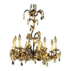 New Italian 8-Arm Chandelier Entwined Gold - This gorgeous Rococo style 8-arm chandelier will sweep you off your feet! This dramatic chandelier has beautiful entwined golden leaves around a black frame and clear glass pendants and clear glass flowers throughout. This chandelier will demand attention anywhere it's placed - in a foyer, dining room, or even a large kitchen with a high ceiling. Overall Condition is New. This item shows normal wear consistent with use as a showroom sample.