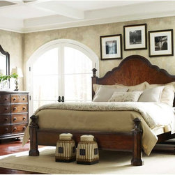 STANLEY CONTINENTAL BARREL BROWN POSTER BED - European elegance and masterfully executed craftsmanship are written all over this design, from the flowing headboard to the detailed carvings to the quarterly walnut inlay. Traditional enough to never go out of style, this beauty is also stylish enough to be complemented by any bedroom's decor.