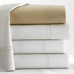 Virtuoso Pillowcase Pair - Elegant pillowcases are often an afterthought in the bedroom, ignored in favor of decorative shams and coverlets.  Make them a luxuriant necessity and pay designer attention to all the details of a suite with the Virtuoso Pillowcase Pair.  Made from 600-thread-count Egyptian cotton and imported from Italy, these pillowcases are tinted in warm, sumptuous neutral metal hues.