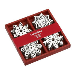 Set of 24 Wooden Snowflake Ornaments - Sometimes I like to tie an ornament in with the ribbon around a gift. It looks festive and fun, and the recipient can then use the decorative touch on their own tree!