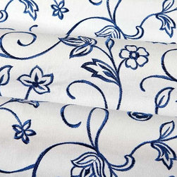 Pavilion Upholstery Fabric in Cadet Blue - Pavillion Upholstery Fabric in Cadet Blue is a floral embroidered 100% cotton fabric with a bright white base with blue embroidery. Perfect for upholstering projects or decorative accent pillows. Made in India with a width of 54: and repeat of 12-7/8″ V X 6-3/8″ H. Passes fire rating UFAC Class 1 or A. Cleaning Code: S