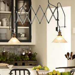 Accordion Dual Kitchen Pendant - Dual lighting can be hard to find, especially for tight places like a double desk or a small kitchen island. This accordion fixture is adjustable to help you shine light in all the right places.