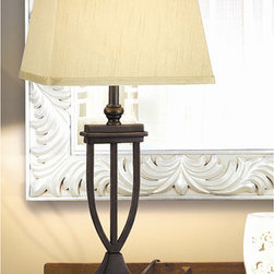 Kenroy - Admiral Bronze Table Lamp - A luxuriously designed base and light gold shade make this elegant bronze table lamp a stately addition to your home decor. A bronze finish gives this light a regal touch, while the on/off rotary switch makes it superbly functional.