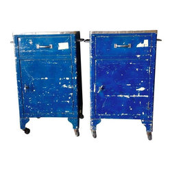 "Used Vintage Blue Industrial AV Carts - A Pair - Hard to find PAIR of matching metal industrial carts from South Dakota State University. They would make great end tables. Blue chippy paint over the original beige with yellow stenciled ""A-V Center SDSU Assigned to Room 216 ENG"" and  ""A-V Center SDSU Assigned to Room 122 AG ENG"". Both roll smoothly on their caster legs. Lots of storage space: both open and close, one has a sticky drawer the other opens easily.  (Total cart size minus handle: 20""W x 16""D x 34.5""H)"