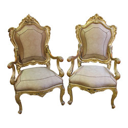 A Regal Pair of 18th Century Carved Giltwood Italian Louis XV Armchairs - A Regal Pair of 18th Century Carved Giltwood Italian Louis XV Armchairs,  accented with nailhead trim, and exhibiting exquisite rocaille carving with delicate fretwork at the cresting, and with the whole raised on cabriole legs