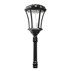 Gama Sonic Victorian Solar Lamp Post and Lamp Head with 13 Bright-White - The Gama Sonic GS-94S-PIR Victorian solar lamp post with a motion-sensing lantern is the perfect energy-saving and money-saving replacement for outdated electric or gas-powered outdoor lighting, plus it offers the security benefit of motion detection. Inspired by 19th-century streetlamps, the unit will add classic style and distinction with modern functionality wherever it's installed. Standing 93 inches tall, the rust-resistant cast-aluminum lamp post and lantern with a powder-coated black finish requires no electrical wiring to set up. Just secure the Victorian GS-94S-PIR to a concrete pad with the included bolts or use Gama Sonic's EZ-Anchor system (sold separately) for in-ground installation. That's it. The sun will do the rest. The internal Lithium Ion battery pack charges when sunlight hits the lighting fixture's integrated solar panel. At dusk, 13 bright-white LEDs will turn on automatically and shine through the beveled glass panes at a brightness of 100 lumens on a full solar charge. Output brightens to 200 lumens for 45 seconds when the motion sensor detects movement up to 20 feet away from the light. Gama Sonic's patented cone reflector enhances the glow and multidirectional light dispersal. The unit is designed for dusk-to-dawn operation after its battery has been fully charged during the day. Beyond providing a superior combination of light brightness and duration, Gama Sonic solar light fixtures are known for their physical durability. The Victorian's monocrystalline silicon solar panel is protected by weather-resistant, cleanable tempered glass that helps ensure long-lasting reliability. The replaceable, plugged battery pack is good for about 1,000 charges. With proper setup for optimal sun exposure, a sunny day without cloud cover should be sufficient to provide a full recharge. Recharging speed will vary based on weather conditions, but no charging will occur if direct sun does not shine on the solar panel. Do not locate the lamp post in a shaded area. At Gama Sonic, our goal is to build the world's best solar lights.