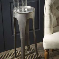 Metal Praque Table - This little side table has an industrial feeling and a ton of character. It has a vintage look to it and would fit well with contemporary or traditional decor either indoor or out.