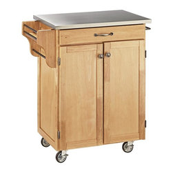 HomeStyles - Kitchen Cart with Stainless Steel Top - This sleek, stainless steel top kitchen cart is a great addition to your home! With its easy clean surface for great prep room, this piece also features a handy drawer, side compartment and a natural wood cabinet. * Solid wood construction. Utility drawer. Metal drawer slides. Two cabinet doors open to storage with adjustable shelf inside. Handy spice rack. Two towel bars. Heavy duty locking rubber casters for easy mobility and safety. Two of the casters lock. Clear coat finish helping to protect against wear from normal use. Made from Asian hardwood and steel. Natural finish. Made in Thailand. 32.5 in. L x 18.75 in. W x 35.5 in. H. Assembly instructions