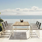 Outdoor Dining Furniture - The simple design of this slated teak outdoor dining table from Mamagreen™ is a perfect foil for the modern style of the stainless steel frame dining chairs.
