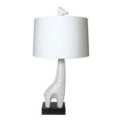 Jonathan Adler - Jonathan Adler Giraffe Lamp - Anything but Ordinary Add something completely unique to your home with the Jonathan Adler Giraffe Lamp. This modern lamp is made of ceramic with a matte white glaze and features a bold geometric pattern that's sure to be noticed.  Jonathan Adler Giraffe Lamp: Made of ceramic Matte white glaze Handmade paper shade 3-way switch Dimensions: 15 in. x 29 in. A Closer Look:  Made of ceramic.  Requires one 150 watt max bulb. About the Brand: Dedicated to bringing style, craft, joy and a general feeling of grooviness to every home, Jonathan Adler is known for his sense of humor and creativity. His designs have long been the favorites of both editors and celebrities.