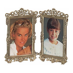 The Renovators Supply - Picture Frames Antique Brass Picture Frame 7 1/2 H x 9 13/16 W | 99835 - Picture Frame. This Victorian double picture frame is cast brass and will give two treasured family photos the perfect look. The Antique Brass finish provides visual depth to the floral accents along the border. It measures 7 1/2 in. H x 9 13/16 in. W. Holds two photos with opening size of 5 5/8 in. H x 3 3/4 in. W. The photos are held in by screw brackets. Photograph backing sold separately.