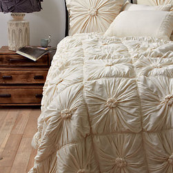 Rosette Quilt - An ivory duvet and pillow set is just feminine enough without being too much. You will be delighted to climb into it on those cold winter evenings.