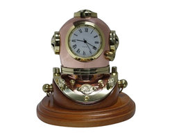 """3"""" Polished Brass & Copper Dive Helmet Clock w/ Wood Base - The polished brass  copper dive helmet clock w/ wood base measures 3"""". This item features hand crafted brass shaped into an intricate dive helmet with a quartz clock in the center and sitting on a wood base. It makes a great gift and is a beautiful addition to the home, office or restaurant/bar."""