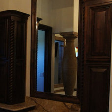 Traditional Bathroom Mirrors by Frameless Glass Systems