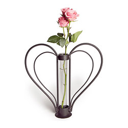 Danya B - Swetheart Iron Heart-shaped Bud Vase - A heart-shape iron stand with removable recycled cylinder glass spotlights this Sweetheart bud vase. The glass tube slides out for easy cleaning and the beautiful heart shape will accent any room.