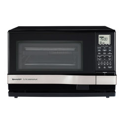 "Sharp - Steam Wave, 1.0 Cu. Ft Steam, Grill, Microwave, 900W, Silver Handle - Today, more and more people aspire to have a healthy lifestyle a lifestyle that includes not only healthy eating, but healthy food preparation as well. One of the best ways to eat healthy is to take control of what you eat by cooking more meals at home. Sharp's SteamWave 3-in-1 oven offers a unique combination of the healthiest ways to cook in one versatile appliance: Steam, Grill, and Microwave. With the SteamWave AX-1100R countertop oven, you won't have to compromise on taste or appearance. It can help you change the way you eat by changing the way you cook! The Sharp SteamWave AX-1100R oven is a 3-in-1 cooking machine. With many automatic options, including a 15-option cooking menu, you can enjoy a large variety of healthy cooked meals in less than 25 minutes.The SteamWave Oven offers a unique combination of the healthiest ways to cook all in one oven: Steam, Grill, and Microwave. It cooks a wide variety of foods without compromising taste or appearance. Meats, poultry, fish and seafood are exceptionally moist and tender. Microwave option provides speed and convenience. LCD and automatic settings assure excellent results. It's the perfect second oven or second microwave. Foods that are good for you will look and taste better than you ever expected. It's not just what you cook, it's how you cook it. Now you can get moist, flavorful results without the addition of fats and oils. SteamWave cooks in so many healthy ways, giving you more control over what you eat and how you cook it. It can help change the way you eat by changing the way you cook. Steam cooking is gentle and easy to use, and foods cooked by traditional steam retain moisture, natural flavors and nutrients. The Steam setting is ideal for vegetables, fish and seafood, as well as for dumplings, tamales and other ethnic specialties. You will taste the many benefits of steam cooking. Meals will retain their moisture and will not dry out during cooking. 900-watts of microwave output and 11 cooking power levels offer a variety cooking options, from boiling your favorite beverage to heating up a dinner plate. Multi-Stage cooking system can be programmed to complete up to 3 different microwave cooking cycles. Sensor Cook, defrost, and reheat options, including popcorn. Steam Engine Heater Wattage - 900 W Grill Heater Wattage - 1100 W Steam Clean Cycle LCD Display Oven Capacity 1.0 cu.ft. Microwave Output Wattage 900 W Steam Cooking - Vegetables, Fish/Seafood, Poached Eggs Microwave - 6 Sensor Cook Settings, Reheat, Popcorn Reheating Options - Microwave Sensor or Manual Steam Defrosting Options - Automatic Microwave Defrost or Steam Defrost AC Line Voltage 120V, 60Hz, AC Only AC Power Required Microwave: 1500W, 13A; Grill/Steam: 1150W, 9.6A Microwave Variable Power Levels - 11 Clock Child Lock Sleep Mode Minute Timer Minute Plus Key 3 Programmable Stages Included Accessories: Non-stick finish racks (2), Glass Tray (1), Grill Rack (1) Safety Compliance FCC, DHHS, and UL Listed Warranty 1 Year Parts/Labor. 4 Additional years for Magnetron tube, part only Cavity Dimensions 13-1/2"" x 8"" x 15"" Outside Dimensions (wxhxd) 20-1/2"" x 13"" x 19-5/8"" Approximate Weight Net: 44 lbs.1.0 cu. ft. multi-purpose oven with 2 layer cooking"