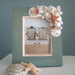 Beach Grass Cottage - This lovely shell frame is made one at a time so no two are alike. Luxuriously hand crafted, these beach photo frames make great conversation pieces and even better gifts!