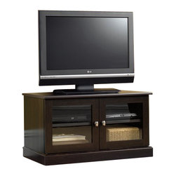 Sauder - Sauder TV Stand in Cinnamon Cherry - Sauder - TV Stands - 412014 - This functional TV Stand features a large adjustable shelf behind framed with safety-tempered and well designed glass doors.  Holds TV's up to 95 pounds. Finish in Cinnamon Cherry.