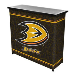 Trademark Global - NHL 2 Shelf Steel Portable Bar with Case Multicolor - NHL8000-AD - Shop for Bars and Bar Sets from Hayneedle.com! Belly up to the NHL 2 Shelf Steel Portable Bar with Case just about anywhere. This super-portable bar is perfect for the parking lot the backyard or in an apartment where space is an issue. It's made entirely of metal with an easy folding collapsible design. There's a spacious bar top for beers and two shelves below for bottles and supplies. It's wrapped in a full-coverage full-color logo wrap of your favorite NHL team. Easy carrying case included.About Trademark Global Inc.Located in Lorain Ohio Trademark Global offers a vast selection of items for your home and lifestyle. Whether you need automotive products collectibles electronics general merchandise home and garden items home decor house wares outdoor supplies sporting goods tools or toys Trademark Global has it at a price you can afford. Decor items and so much more are the hallmark of this company.