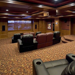 Home Theater - Home theater projector, projection screen, surround sound and seating.