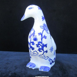 Chinese Handmade Blue & White Display Duck Statue - This elegant display duck statue is made of porcelain and has beautiful blue and white color. It is an eye catching decor for your living room or your office.