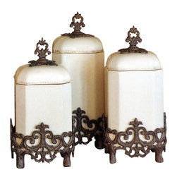 "Gracious Goods GG - GG Provincial Cream Canister Set - Complete your French Country or Old World decorating theme with these wonderfully unique ceramic canisters. Our Provencial from the GG Collection canisters are ideal for holding staples such as grains, sugar, flour and tea. Their unique shapes, rounded lids with finial knobs and fleur-de-lis embellished bases add a traditional decorative touch. Canisters easily lift out of their decorative aluminum bases when in use.   * Set of 3 Cream  * Airtight lids keep foods fresh  * Jars and lids are dishwasher safe.  * Handcrafted of ceramic and aluminum   * Small 7"" w  x  7""d  x 14""h   * Medium 7""w  x  7""d  x  15""h   * Large 7""w  x  7""d  x  16""h"