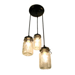 Mason Jar Chandelier Trio with Vintage Quart Jars, Oil Rubbed Bronze - A handcrafted chandelier lights a trio of clear, vintage canning jars keeping their aged charm with the original wire-bails and raised lettering.