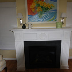 Fireplace Mantel - Maple fireplace mantel with panel molding, fluting and large carved shell at center.