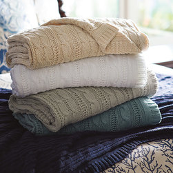 Frontgate - Cotton Cableknit Throw - In Burlap, Ivory, Juniper, Navy, Persimmon, Saffron, Sand, Smoke Blue and White. Soft colors complement our relaxed Sophisticated Coastal collection. Machine wash with cold water; medium dry. The ideal accessory for cool nights by the coast, our classic Cotton Cable Knit Throw entices with a luxuriously soft hand and iconic chunky texture. Made of 100% cotton, the easy-wash blanket is finished with a classic rib knit trim to beautifully maintain its shape.  .  .  . Made in USA.