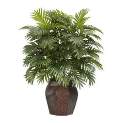 Areca Palm with Vase Silk Plant - Put down the machete! The Areca Palm with its thick lush leaves is the bane of jungle travel, but perfect for improving the mood of any room. Hailing from Madagascar, the Areca Palm, with its deep rich tropic decor, is sure to delight anyone who dreams of relaxing on a beach surrounded by greenery. Reaching upward at 38 inches and complete with a decorative patterned vase, it's an elegant addition anywhere. Height= 38 in x Width= 27 in x Depth= 25 in