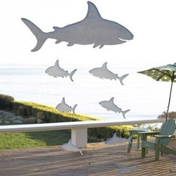 "Shark Mobile - Overall (flat): 31"" wide x 0.25"" deep x 50"" long Sharks are crafted of lightweight wood and hand painted with a weathered finish. Mobile hangs from two separate loops; hanging line included. Overall (flat): 31"" wide x 0.25"" deep x 50"" long Shark (large): 30.5"" wide x 12"" high Shark (8): 6-12"" wide x 2.5-4.75"" high"