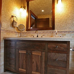 Live Edge Fine Woodworking - Claro walnut was crafted into the vanity, mirror, and built-in for a home on Lake Erie. The live (natural) edges of the wood planks were maintained for the door frames and top of the mirror frame.