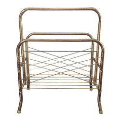 Used Vintage Brass Magazine Rack - A vintage brass magazine rack to hold all of your great reads! Clear plastic feet to prevent scratching the floor. There is some minor tarnishing on the side rails but, it's hardly noticeable .