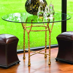 Gold Chiseled Dining Table - This striking dining table makes a big impact in a small space. We love how the glass top lets the base shine.