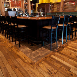 German Gasthaus Series by Shamrock Plank Flooring shown in Pilsner - German Gasthaus Series by Shamrock Plank Flooring.  Hand scraped Hickory shown in Pilsner.  The series features 10 designer colors in a variety of species and textures. Visit www.shamrockplankflooring.com for more information.  Photo taken at Biaggi's Restaurant / Chicago