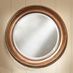 "Casual Essence 30"" D Round Framed Mirror - This round vanity mirror is made of solid hardwood and matches the Casual Essence vanity. It features a sculpted rim and beveled mirror edge."